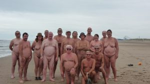 Group of naked people on beach